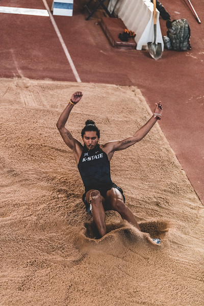 K-State sophomore Tejaswin Shankar lands feet first in the sand while taking part in the long jump during the Carol Robinson/Attila Zsivoczky Pentathlon in Ahern on December 7, 2018. (Alex Todd   Collegian Media Group)