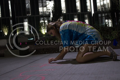 Sara Wallace, sophomore in journalism, chalks a message of inclusion outside of Seaton Hall on September 13, 2017. (Regan Tokos | Collegian Media Group)