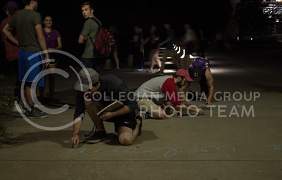 After white nationalist posters where seen around campus, students chalk messages of inclusion and kindness to show their support for diversity on September 13, 2017. (Regan Tokos | Collegian Media Group)