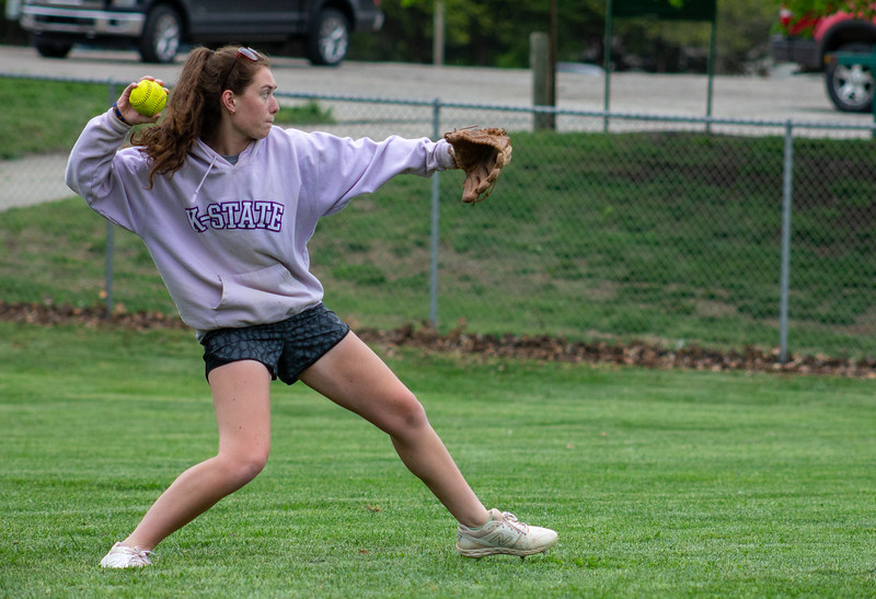Freshman Lydia Waner fields a ball during a drill at a Monday night practice for K-State's club softball team.  The girls wrapped up the Spring portion of their season last weekend at the Mid-American Regional Tournament in Kansas City.  (Caleb Pfeifer | Collegian Media Group)