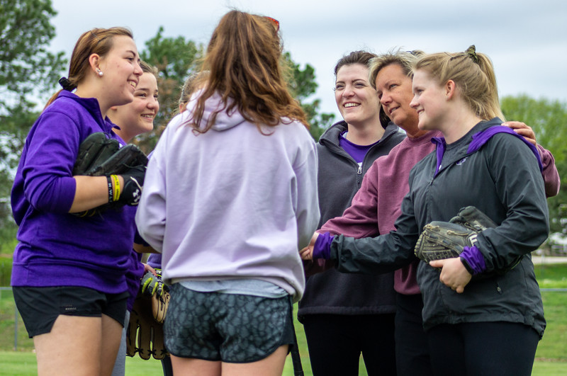 Members of the K-State club softball team gather together after a brief Monday night practice.  The girls wrapped up the Spring portion of their season last weekend at the Mid-American Regional Tournament in Kansas City. (Caleb Pfeifer | Collegian Media Group)