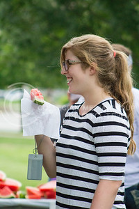 Katie Clarkson, freshman in animal science, takes part in the annual watermelon feed put on by the College of Agriculture on Aug. 30, 2016. (Maddie Domnick | The Collegian).