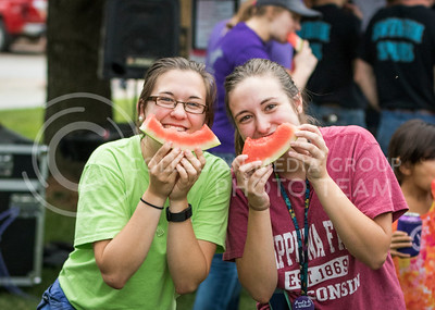 Amelia Welter, freshman in food science, and Marie Jackson, freshman in mechanical engineering, pose with their partly-eaten watermelon slices at the College of Agriculture Watermelon Feed on Aug. 30, 2016. (John Benfer | The Collegian)