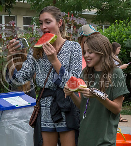 Paige Reed, freshman in animal science, and Isabella Grivois, sophomore in animal science, take a selfie during the College of Agriculture Annual Watermelon Feed on Weber lawn on Aug. 30, 2016. (Nathan Jones | The Collegian)