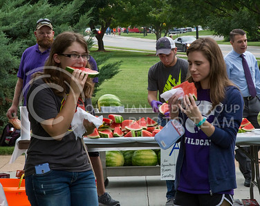 Megan Owens, freshman in agronomy, and Michaela Warnke, freshman in animal science, chow down on watermelon during the College of Agriculture Annual Watermelon Feed on Weber lawn on Aug. 30, 2016. (Nathan Jones | The Collegian)