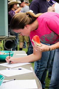Allison Wakefield, freshman in agricultural communication and journalism, signs up for an agricultural organization at the annual watermelon feed hosted by the College of Agriculture at Weber Arena on Aug. 30, 2016. The watermelon feed was hosted to help new students get involved in organizations and clubs in the agriculture department.  (Alanud Alanazi | The Collegian)