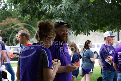 Jeff Ausin, senior in park management and conservation, eats watermelon at the K-State College of Agriculture Annual Watermelon Feed on Aug. 30, 2016. (Payton Heinze | The Collegian)