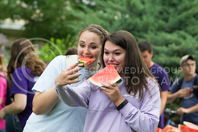 Tessa Zee, junior in agronomy, and Celine Beggs, senior in agriculture communications and economy, take a selfie at the annual watermelon feed organized by the College of Agriculture on Aug. 30, 2016. (Maddie Domnick | The Collegian).
