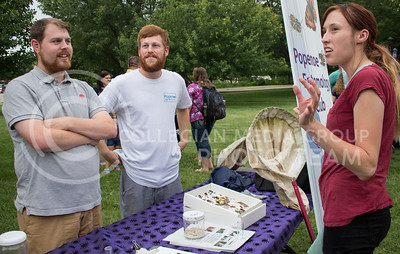 Mckynzie Mann (right), senior in horticulture, talks about the Popenoe Entomology club with Joe Krauska (center), graduate student in entomology, and Stephen Losey (left), graduate student in entomology, during the College of Agriculture Annual Watermelon Feed on the Weber Hall lawn on Aug. 30, 2016. (Miranda Snyder | The Collegian)