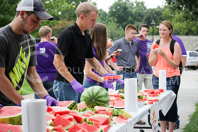 Jacob Winkel, senior in wildlife and outdoor enterprise management, and Bret Gum, junior in agriculture economics, slice the watermelon at the annual watermelon feed hosted by the College of Agriculture to serve to students as they browse the different agriculture organizations. The watermelon feed was hosted to help new students join organizations and clubs in the agricultural department.  (Alanud Alanazi | The Collegian)