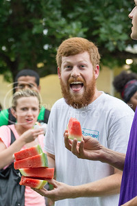 Joe Krauska, graduate student in entomology, takes part in the annual watermelon feed put on by the College of Agriculture on Aug. 30, 2016. (Maddie Domnick | The Collegian)