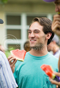 Max Ruby, junior in entomology, enjoys the annual watermelon feed put on by the College of Agriculture on Aug. 30, 2016. (Maddie Domnick | The Collegian)