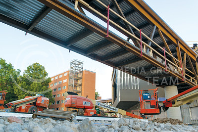 New walkways under construction cross from Marlatt Hall and Goodnow Hall to connect with Wefald Hall on July 5, 2016. Wefald Hall is explected to be completed by August while improvements to Goodnow and Marlatt will extend until 2018.  (Evert Nelson | The Collegian)