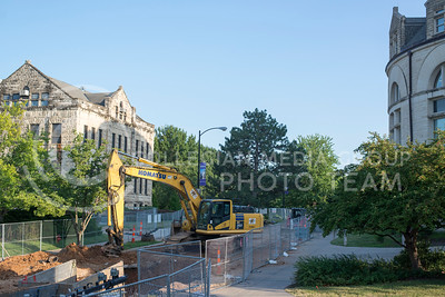 Mid-Campus drive remains dug up as work continues on the main water line and transforming the street into a pedestrian walkway on July 5, 2016. (Evert Nelson   The Collegian)