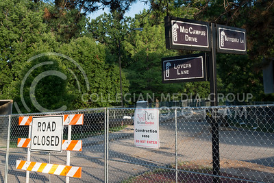 Construction fences and signs line Mid-Campus Drive in front of Anderson Hall on July 5, 2016 as work continues in various sites around campus. (Evert Nelson | The Collegian)