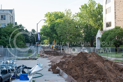 Loads of dirt and construction material fill Mid-Campus drive as work continues transforming the street for new water lines and into a pedestrian walkway on July 5, 2016. (Evert Nelson | The Collegian)