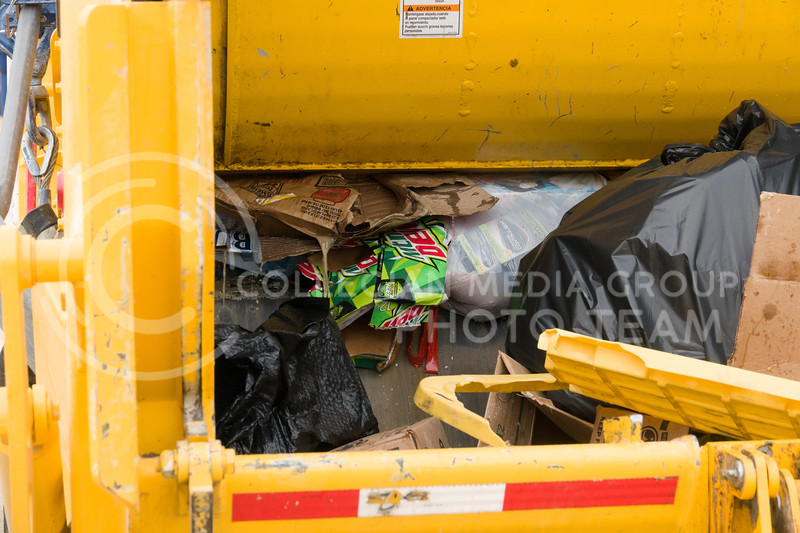 A garbage truck made the rounds the morning after the Country Stampede, a country music festival hosted in Tuttle Creek Park from June 21 - 23. (Alex Masson | Collegian Media Group)