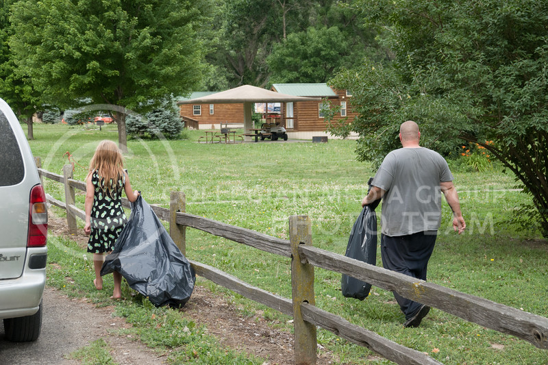 A father and daughter team made the rounds cleaning up trash the morning after the Country Stampede, a country music festival hosted in Tuttle Creek Park from June 21 - 23. (Alex Masson | Collegian Media Group)