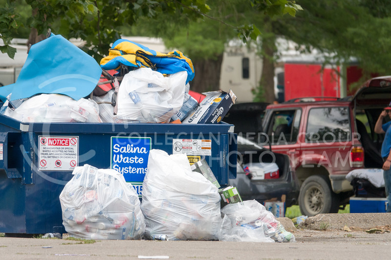 Trash overflows from a dumpster on the morning after the Country Stampede, a country music festival hosted from June 21 - 23 in Tuttle Creek Park. (Alex Masson | Collegian Media Group)