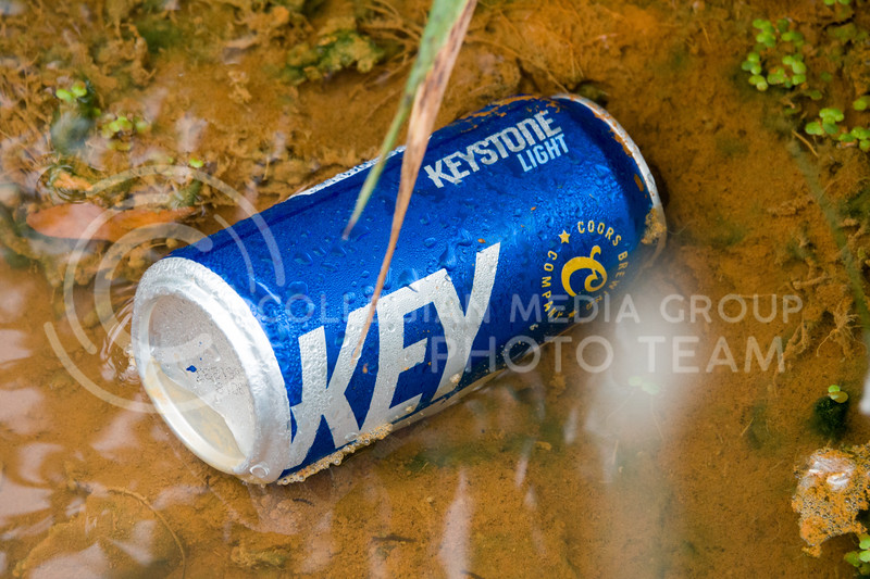 A beercan laid in a stream on the morning after of the Country Stampede, a country music festival hosted in Tuttle Creek Park from June 21 - 23. (Alex Masson | Collegian Media Group)