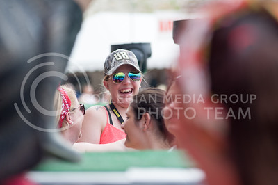 A spectator at Country Stampede smiles as the country musician Countney Cole performs on the main stage on June 23, 2016. (Photo by Evert Nelson | The Collegian)