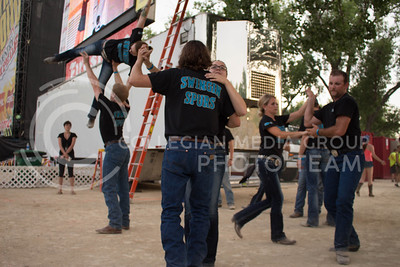Members of the Swinging Spurs perform stageside during day 1 of Country Stampede on Thursday. (Photo by Michael Weninger | The Collegian)