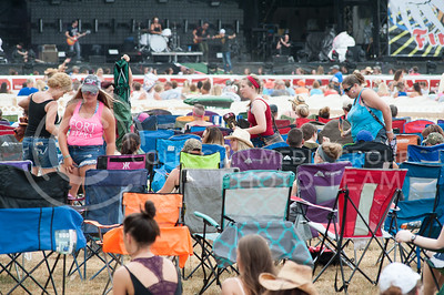 People stake their spots with lawn chairs in front of the main stage of Country Stampede on June 23, 2016. (Photo by Evert Nelson | The Collegian)