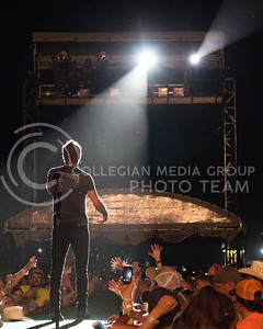 Dierks Bentley sings to the crowd during day 1 of Country Stampede on Thursday. (Photo by Michael Weninger | The Collegian)