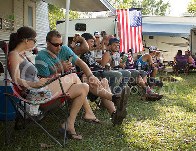 Concertgoers hang out at the campgrounds during the second day of Country Stampede while waiting for intermission to end. (Photo by Michael Weninger | The Collegian)