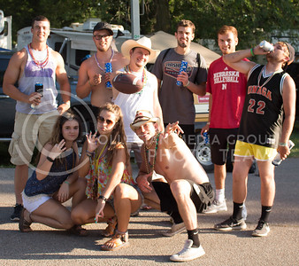 A group of patrons at Country Stampede pose for a photo inside the campgrounds on June 24, 2016. (Photo by Michael Weninger | The Collegian)
