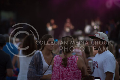 Country Stampede attendees gather while the band on stage warms up on July 24th, 2016. (Sarah Falcon | The Collegian)