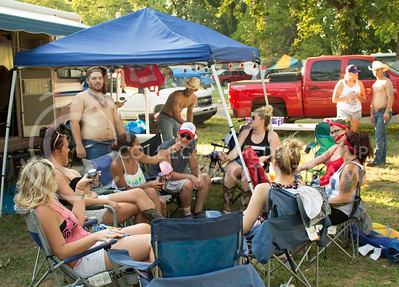 Concertgoers hang out together at the Country Stampedes campgrounds Friday afternoon. (Photo by Michael Weninger | The Collegian)