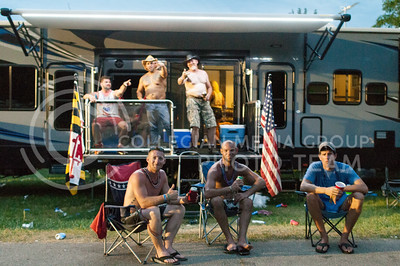 Campers pose outside of their RV in the campgrounds of Tuttle Creek inbetween sets at Country Stampede on June 25, 2016. (Photo by Evert Nelson | The Collegian)
