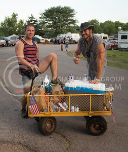 """Adam Mann (right) and Ethan Schroeder (left) of Omaha, Nebraska show off their """"Porta-Party"""" Saturday afternoon at the Country Stampede campgrounds. (Photo by Michael Weninger 