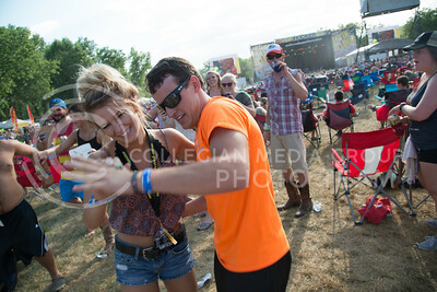 A couple dances at Country Stampede on June 25, 2016 while music plays on the main stage. (Photo by Evert Nelson | The Collegian)