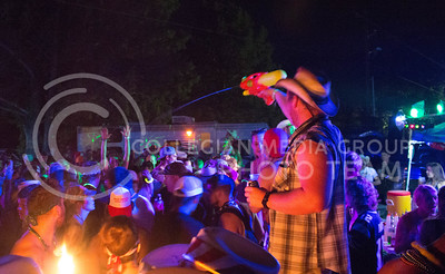 """Matt Seiwert of Conway Springs sprays partygoers Saturday night at """"Club Stampede"""" in the Country Stampede campgrounds. (Photo by Michael Weninger 