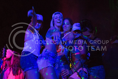 """Paige Sisco (second from the left) of Burchard, Nebraska dances with friends Saturday night at the """"Club Stampede"""" in the Country Stampede campgrounds. (Photo by Michael Weninger 