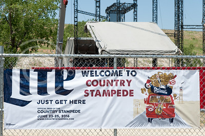 A banner welcomes guests to 'just get here' on the site of Country Stampede on June 21, 2016. The event at Tuttle Creek State Park is on its 21st year. (Photo by Evert Nelson | The Collegian)