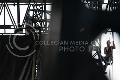 Cory Reed, with Premiere Global Productions, works to secure the roof for the main stage of Country Stampede on June 21, 2016 at Tuttle Creek State park. (Photo by Evert Nelson | The Collegian)