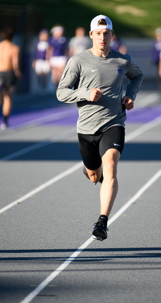 KSU Cross Country athlete, Jack Moore, runs around the R.V. Christian Track and Field complex on Oct 25, 2019. (Dylan Connell | Collegian Media Group)