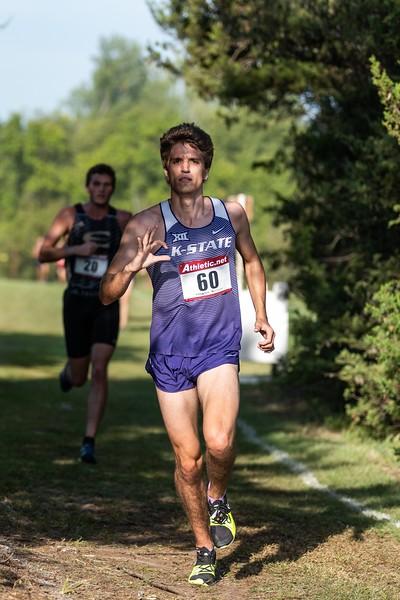 Kurtis Loevenstein, K-State junior in Kinesiology, shows some pride during the men's 6k race at the J.K. Gold Classic in Augusta, KS on September 1, 2018. (Alex Todd | Collegian Media Group)