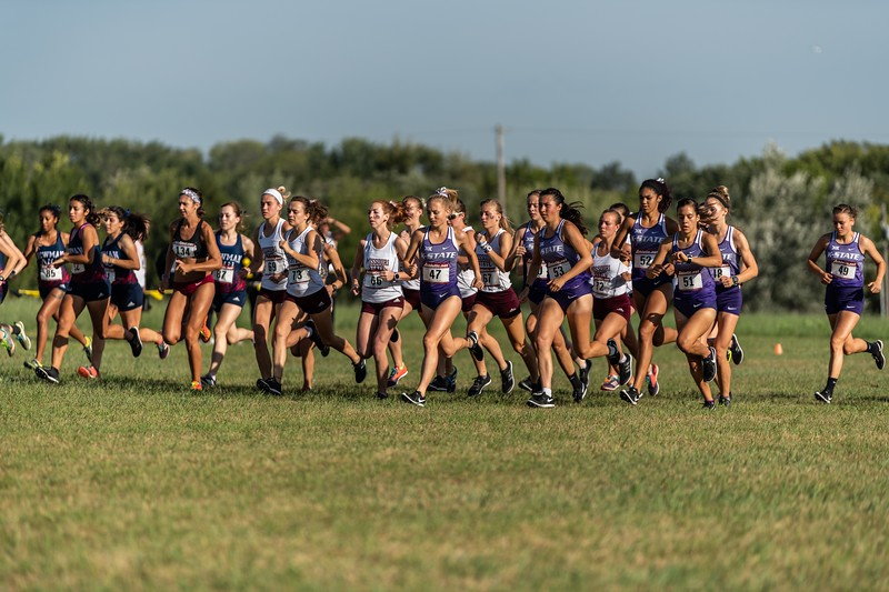 The women's cross country team as they come off the starting line at the J.K. Gold Classic in Augusta, KS on September 1, 2018. (Alex Todd | Collegian Media Group)