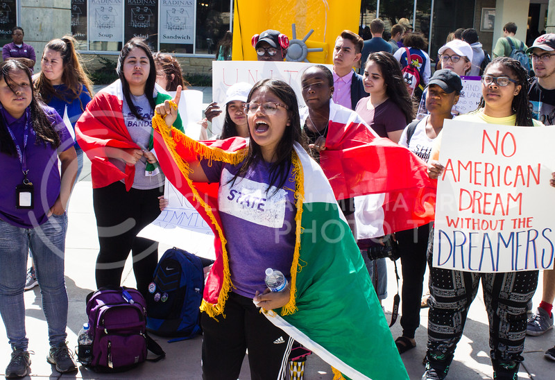Leslie Ramirez, sophomore in secondary education, leads a chant at a rally for Deferred Action for Childhood Arrival (DACA) recipients. The rally was held in Bosco Plaza on September 6, 2017, days after President Trump announced efforts would be made to roll back DACA. (Regan Tokos | Collegian Media Group)