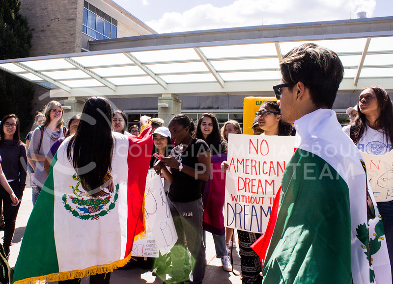 Students gather in support for Deferred Action for Childhood Arrival (DACA) recipients. A rally was held in Bosco Plaza on September 6, 2017, days after President Trump announced efforts would be made to roll back DACA. (Regan Tokos | Collegian Media Group)