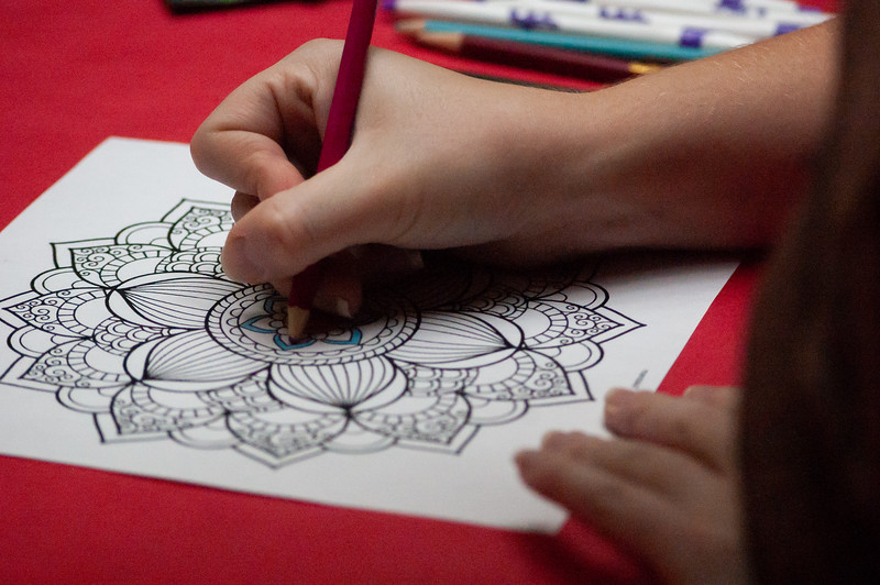 Students color in mandalas during the Draw Out Your Emotions event. Coordinated and planed by Colin Gallery, a Junior in Psychology, chose mandalas because the circular shapes have proven calming effects. (Rowan Jones|Collegian Media Group)