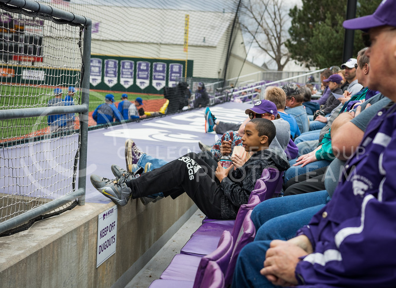 A K-State baseball game attendee sits and watches the game against Eastern Illinois University at Tointon Family Stadium on Mar. 5, 2017. (John Benfer | The Collegian)