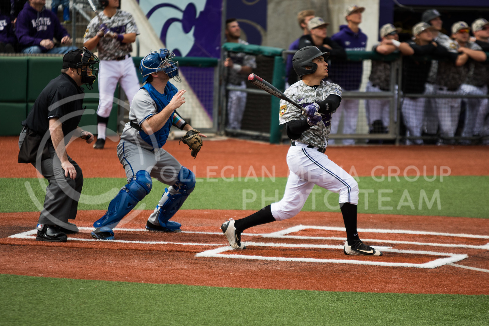 Sophomore catcher Josh Rolette hits the ball while at bat during the K-State baseball game against Eastern Illisnois University at Tointon Family Stadium on Mar. 5, 2017. (John Benfer | The Collegian)