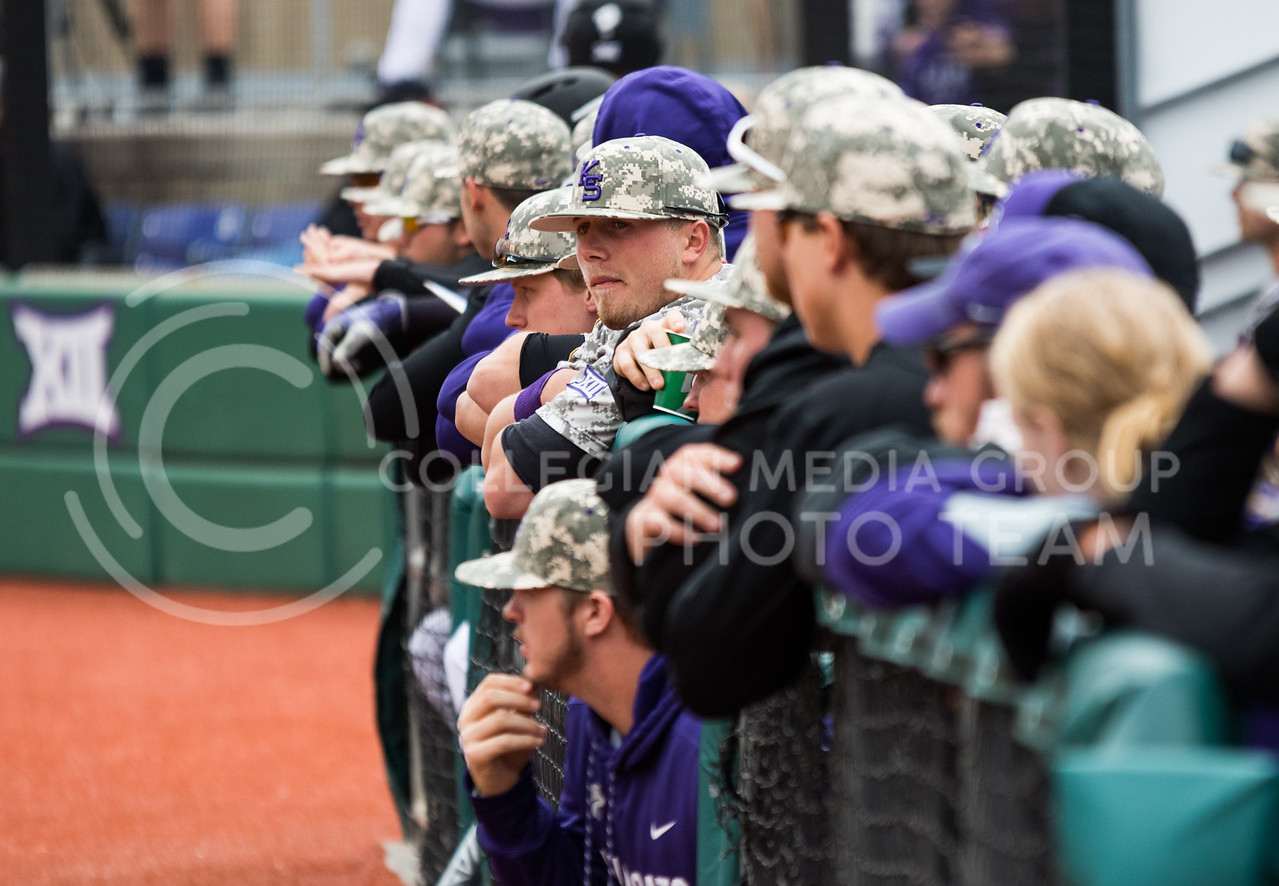 Wildcat players watch their game in their dugout at the K-State baseball game against Eastern Illisnois University at Tointon Family Stadium on Mar. 5, 2017. (John Benfer | The Collegian)
