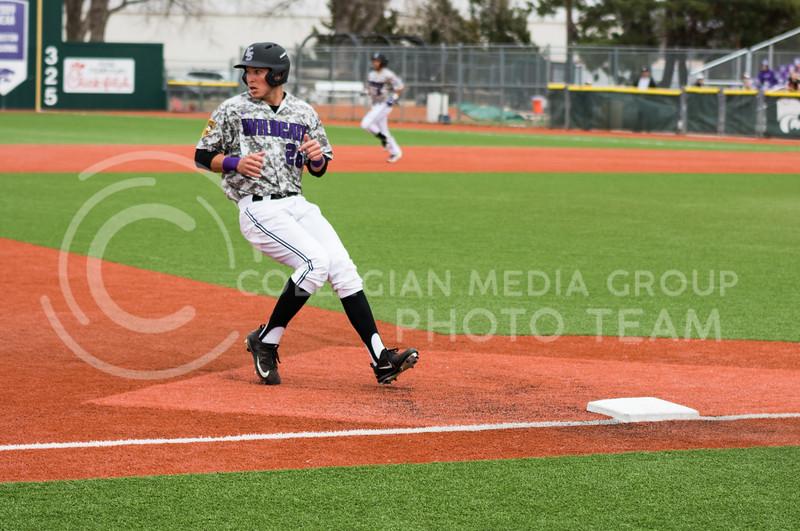 Junior outfileder Hanz Harker runs to third base at the K-State baseball game against Eastern Illisnois University at Tointon Family Stadium on Mar. 5, 2017. (John Benfer | The Collegian)