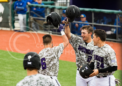 Senior Josh Ethier, Senior Quintin Crandall, and Sophomore Josh Rolette cheer togetherafter K-State scored in their game against Eastern Illisnois University at Tointon Family Stadium on Mar. 5, 2017. (John Benfer | The Collegian)